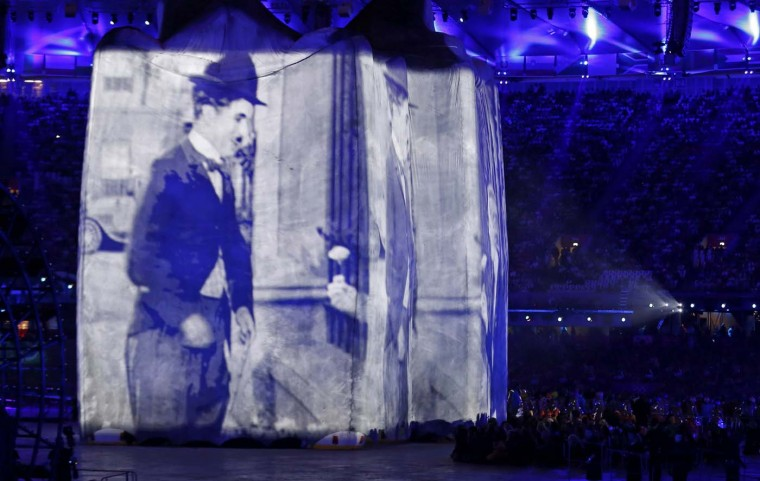 Image of actor Charlie Chaplin is projected onto a structure during the opening ceremony of the London 2012 Olympic Games at the Olympic Stadium July 27, 2012. (Mike Blake/Reuters)