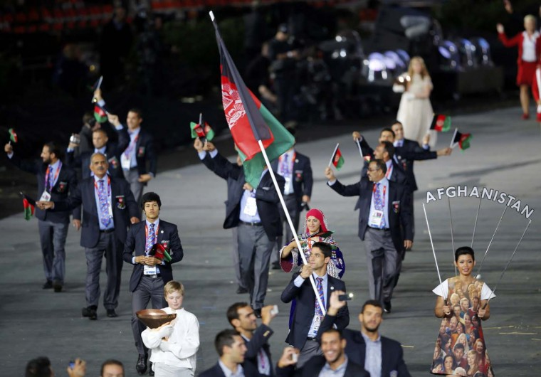 Afghanistan's flag bearer Nesar Ahmad Bahawi holds the national flag as he leads the contingent in the athletes parade during the opening ceremony of the London 2012 Olympic Games at the Olympic Stadium July 27, 2012. (Mike Blake/Reuters)
