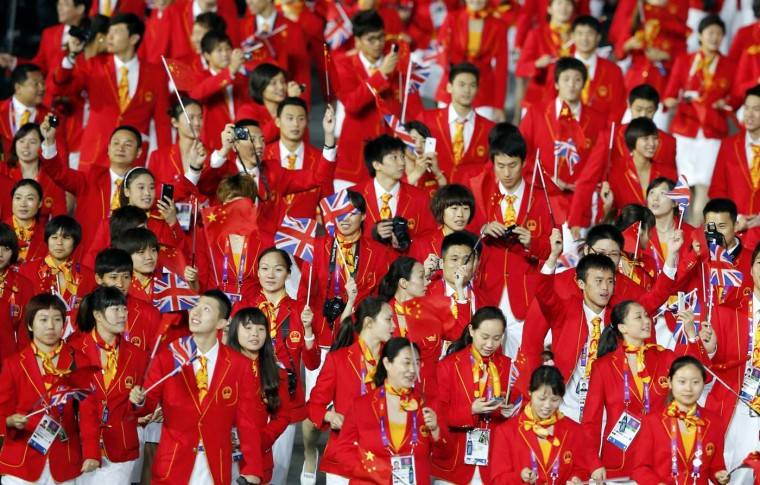 Members of China's contingent wave union flags as they take part in the athletes parade during the opening ceremony of the London 2012 Olympic Games at the Olympic Stadium July 27, 2012. (Mike Blake/Reuters)