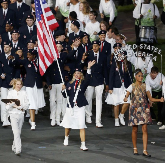 Flag bearer Mariel Zagunis of the U.S. holds the national flag as she leads the contingent in the athletes parade during the opening ceremony of the London 2012 Olympic Games at the Olympic Stadium July 27, 2012. (Damir Sagolj/Reuters)