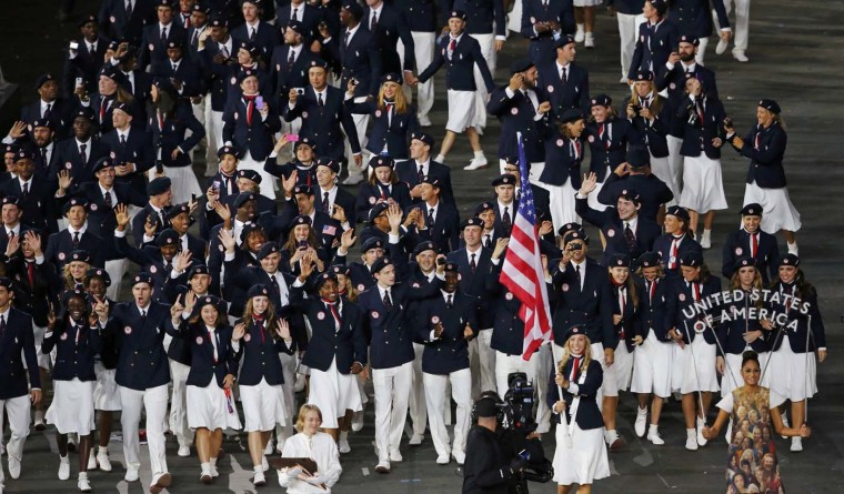 Flag bearer Mariel Zagunis of the U.S. holds the national flag as she leads the contingent in the athletes parade during the opening ceremony of the London 2012 Olympic Games at the Olympic Stadium July 27, 2012. (Jorge Silva/Reuters)