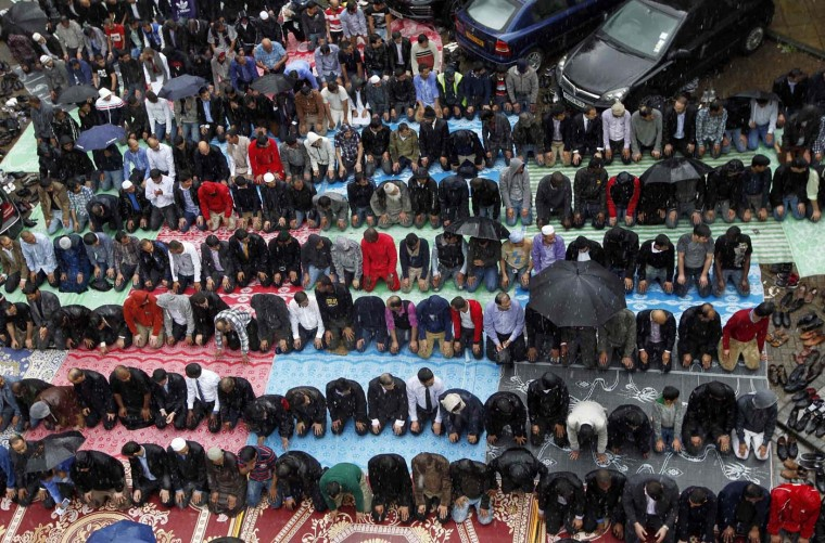 Muslims attend Friday prayers on the first day of Ramadan, at the courtyard of a housing estate next to a small BBC community centre and mosque in east London July 20, 2012. (Chris Helgren/Reuters)