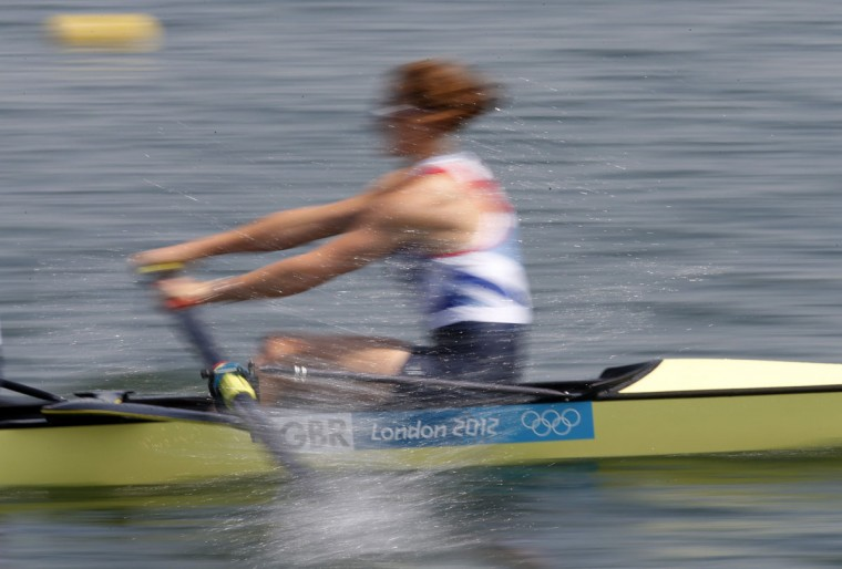 Team GB's Olivia Whitlam, competing in the women's eight rowing event, trains at Eton Dorney near London in preparation for the London 2012 Olympic Games July 26, 2012. (Jim Young/Reuters)