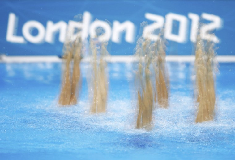 A synchronized swimming team practices before the start of the London 2012 Olympic Games July 26, 2012. (Jorge Silva/Reuters)