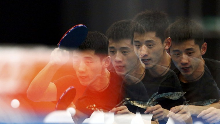 China's Zhang Jike trains during a table tennis practice session at the ExCel venue before the start of the London 2012 Olympic Games July 26, 2012. This picture was taken using multiple exposures. (Grigory Dukor/Reuters)