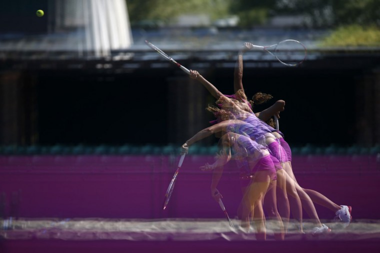 Czech Republic's Petra Kvitova serves during a training session at the All England Lawn Tennis Club before the start of the London 2012 Olympic Games in London July 26, 2012. Picture taken using multiple exposures. (Stefan Wermuth/Reuters)