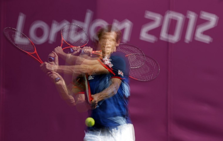 Britain's Andy Murray returns the ball during a training session at the All England Lawn Tennis Club ahead of the London 2012 Olympic Games in London July 25, 2012. Picture taken using multiple exposures. (Stefan Wermuth/Reuters)