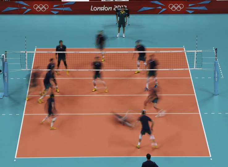 Australia's men's volleyball team trains before the start of the men's volleyball competition at the London 2012 Olympic Games, in London July 26, 2012. (Ivan Alvarado/Reuters)