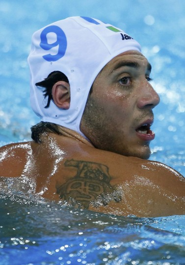 Italy's Christian Presciutti reacts during their men's preliminary round Group A water polo match against Croatia at the London 2012 Olympic Games at the Water Polo Arena August 2, 2012. (Kai Pfaffenbach/Reuters)