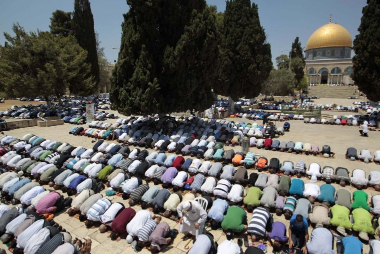 Palestinian men pray in front the Dome of the Rock on the compound known to Muslims as Noble Sanctuary and to Jews as Temple Mount in Jerusalem's Old City on the first Friday of the holy month of Ramadan July 20, 2012. (Ammar Awad/Reuters)