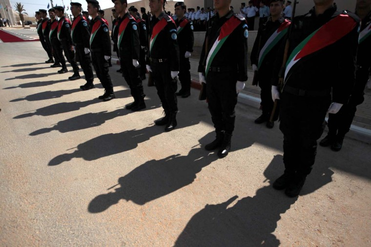 Palestinian policemen stand at attention before the arrival of Prime Minister Salam Fayyad and European Commission President Jose Manuel Barroso for the inauguration of the Palestine College for Police Sciences (PCPS) in the West Bank city of Jericho July 8, 2012. (Ammar Awad/Reuters)