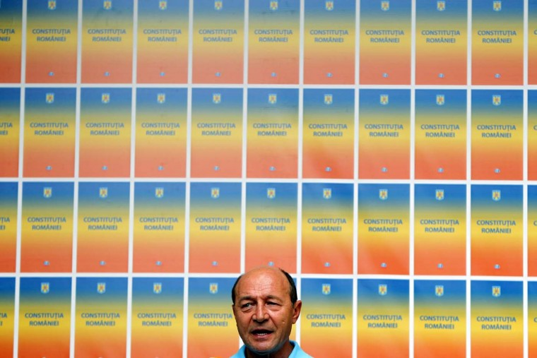 Romania's suspended President Traian Basescu addresses media after a referendum for his impeachment in Bucharest July 30, 2012. Romania's President Basescu survived a referendum on his impeachment on Sunday after the voter turnout fell short of the required level and derailed an effort by his opponents to oust him from office. (Bogdan Cristel/Reuters)