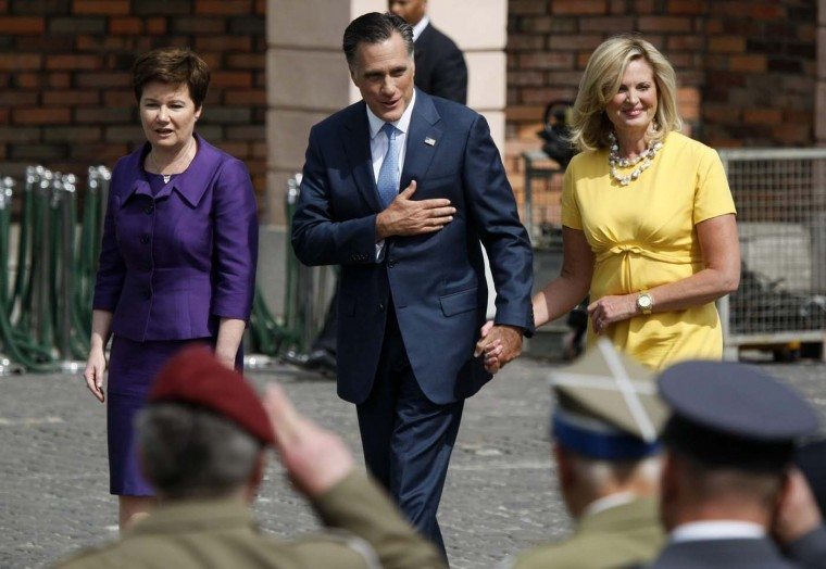 U.S. Republican Presidential candidate Mitt Romney and his wife Ann and Warsaw Mayor Hanna Gronkiewicz-Waltz (L) visit the Warsaw Uprising Monument in Warsaw, July 31, 2012. (Kacper Pempel/Reuters)