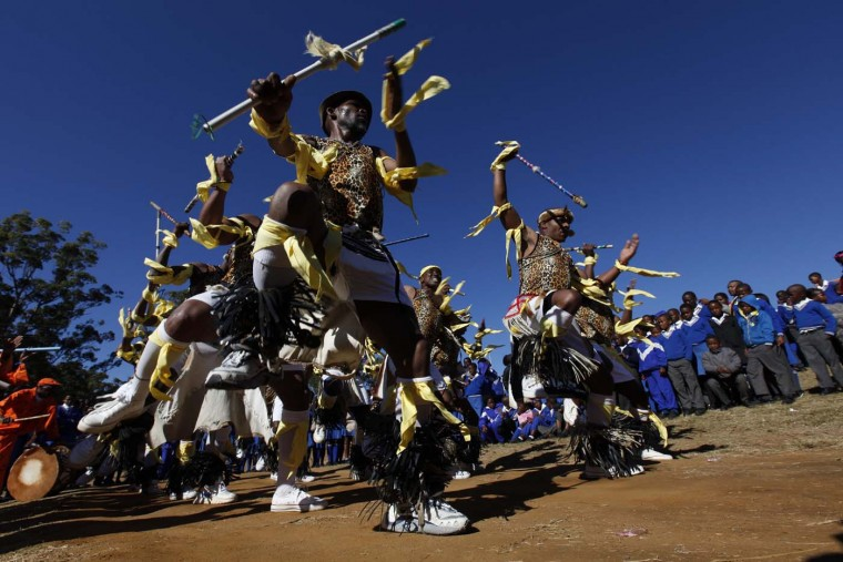 "Inmates perform for school children in Qunu, July 18, 2012. South Africans celebrated former president Nelson Mandela's 94th birthday on Wednesday with special events and charity work in what has become known as ""Mandela Day."" (Siphiwe Sibeko/Reuters)"