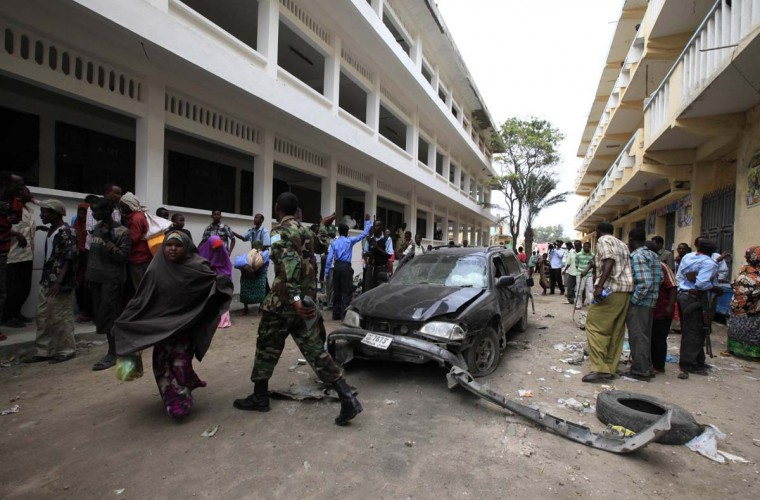 People gather at the scene of a suicide car comb attack in the Hamarwayne district of Somalia's capital Mogadishu. The car bomb killed a Somali lawmaker allied to the president, an official said. (Omar Faruk/Reuters photo)