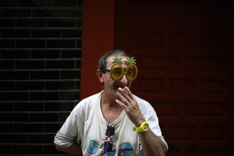 A reveller smokes a cigar on the second day of the San Fermin festival in Pamplona. (Vincent West/Reuters photo)