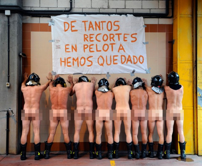 "Firefighters of the Mieres Fire Station in Asturias, northern Spain, pose naked with a sign reading ""With so many funding cuts, we are left naked,"" to protest against new austerity measures. Protests by a wide range of government workers have continued for days after conservative Prime Minister Mariano Rajoy announced, on July 13, new measures to lower latest Spain's deficit, a 65-billion-euro (80 billion USD) austerity package involving among other things an increase in the VAT (TVA) tax and cuts in unemployment benefits. (Cesar Manso/AFP/Getty Images)"