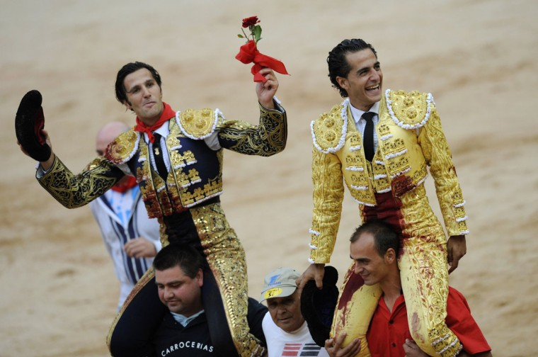 Spanish bullfighters David Mora (L) and Ivan Fandino celebrate after being awarded with a bull's ear following bullfights at the San Fermin festival in Pamplona July 10, 2012. (Eloy Alonso/Reuters)
