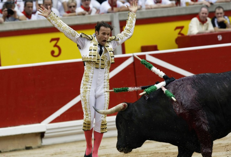 Spanish bullfighter Antonio Ferrera performs during the first bullfight of the San Fermin festival in Pamplona July 7, 2012. (Joseba Etxaburu/Reuters)