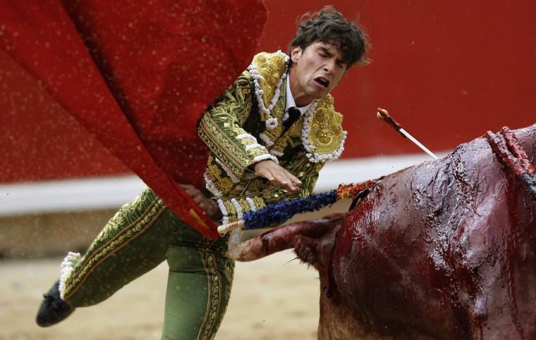 Spanish bullfighter Eduardo Gallo performs during the first bullfight of the San Fermin festival in Pamplona July 7, 2012. (Joseba Etxaburu/Reuters)