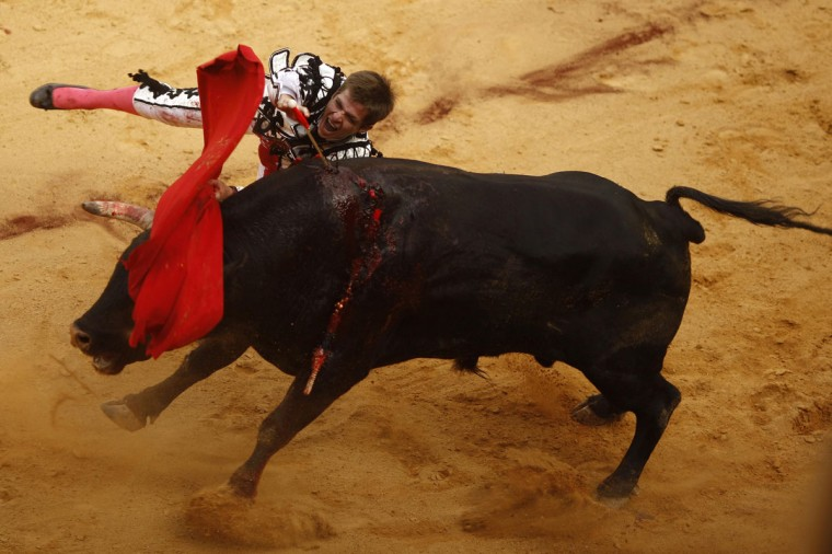 "Spanish bullfighter Julian Lopez ""El Juli"" drives the sword into a bull during a ""Corrida Goyesca"" bullfight in Ronda, southern Spain, September 3, 2011. In the annual ""Corrida Goyesca"" fight in Ronda's historic bullring the bullfighters wear costumes from the era of 18th Century painter Francisco Goya. (Jon Nazca/Reuters)"