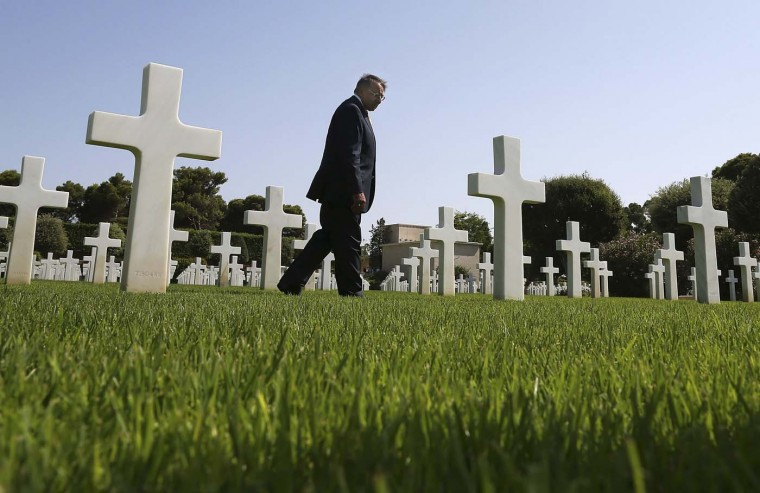 U.S. Secretary of Defense Leon Panetta tours the North Africa American Cemetery where 2,841 U.S. soldiers killed in World War II are buried, in Tunis July 30, 2012. Panetta is on a five-day trip to the Middle-East with stops in Tunisia, Egypt, Israel and Jordan before returning to Washington. (Mark Wilson/Reuters)