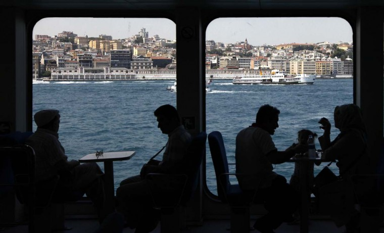 People travel over the Bosphorus in a passenger-vehicle ferry in Istanbul. (Murad Sezer/Reuters photo)