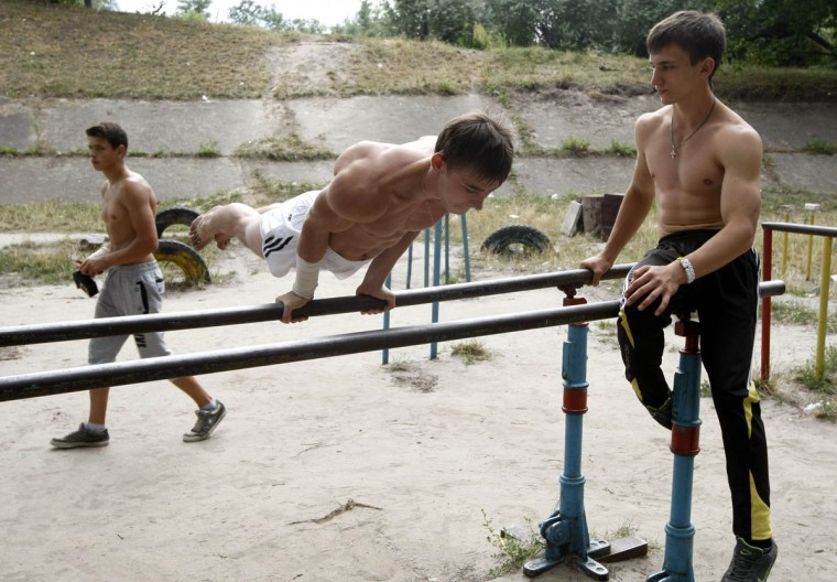 Young men train at a public exercise area in the Ukranian capital Kiev. (Anatolii Stepanov/Reuters)