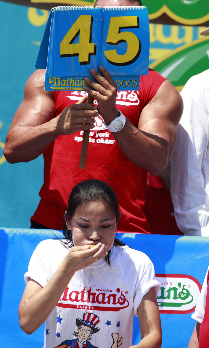 Sonya Thomas competes in the 2012 Nathan's Famous Fourth of July International Eating Contest at Coney Island in the Brooklyn borough of New York. Thomas broke her record by eating 45 hot dogs to take the crown. (Eric Thayer/Reuters photo)
