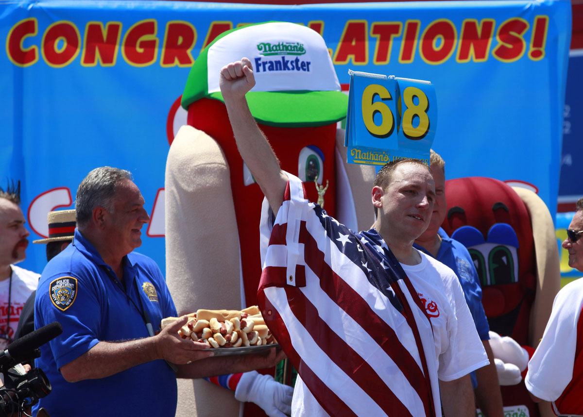 Joey Chestnut celebrates after winning the 2012 Nathan's Famous Fourth of July International Eating Contest at Coney Island in the Brooklyn borough of New York. (Eric Thayer, Reuters photo)