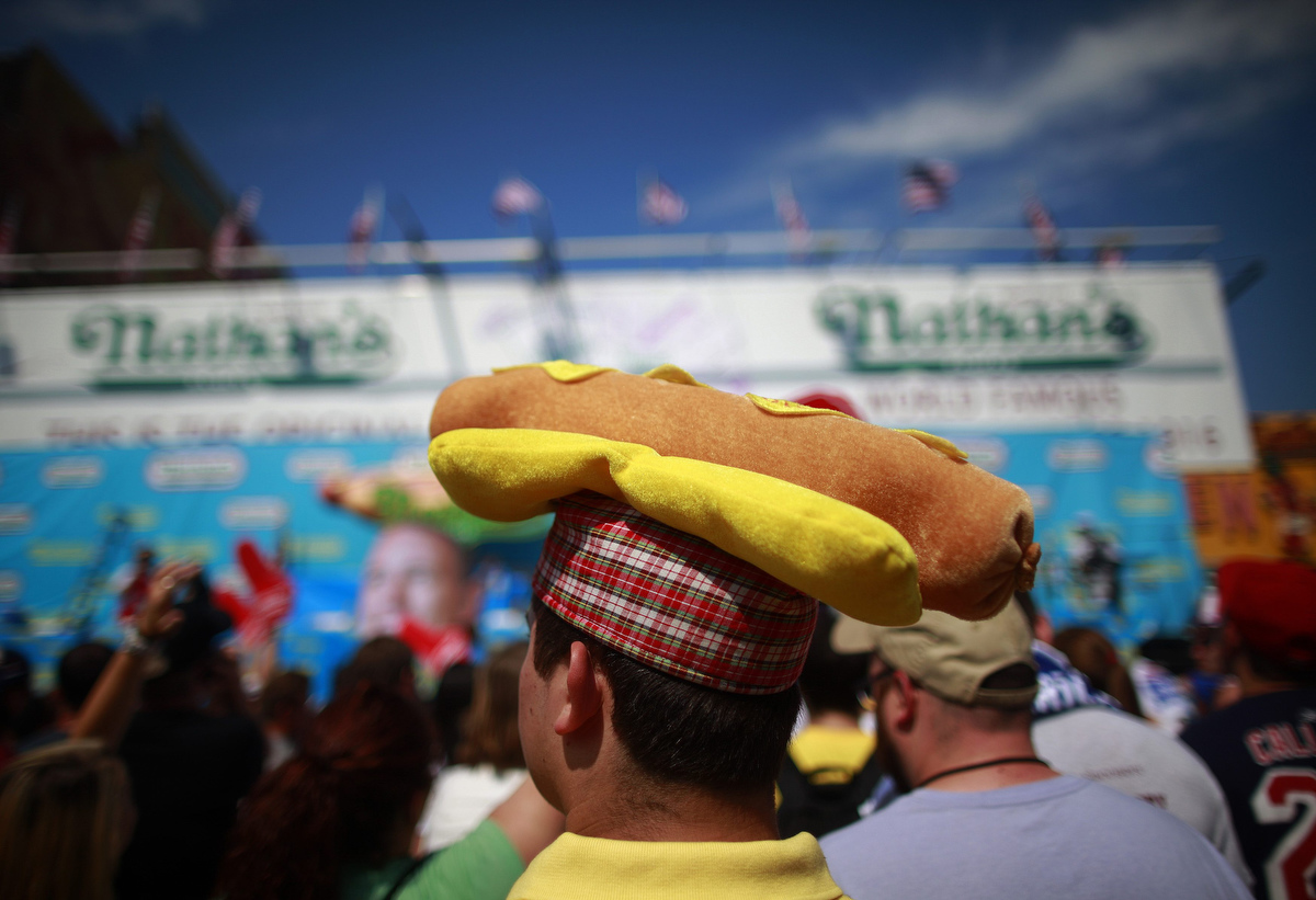 Spectators wait for the 2012 Nathan's Famous Fourth of July International Eating Contest at Coney Island in the Brooklyn borough of New York. (Eric Thayer, Reuters photo)