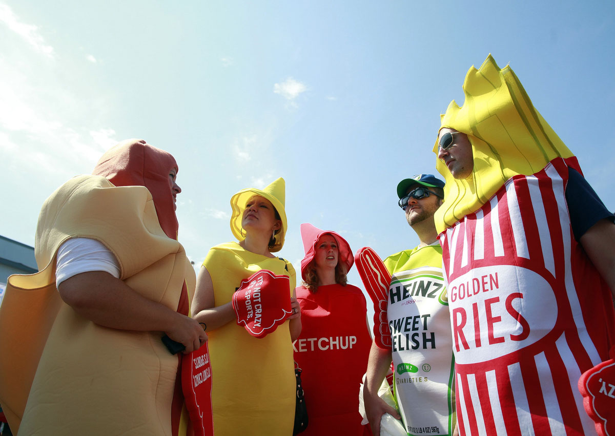 Spectators, dressed as a hot dog, mustard, ketchup, relish and fries, wait for the 2012 Nathan's Famous Fourth of July International Eating Contest at Coney Island in the Brooklyn borough of New York. (Eric Thayer, Reuters photo)