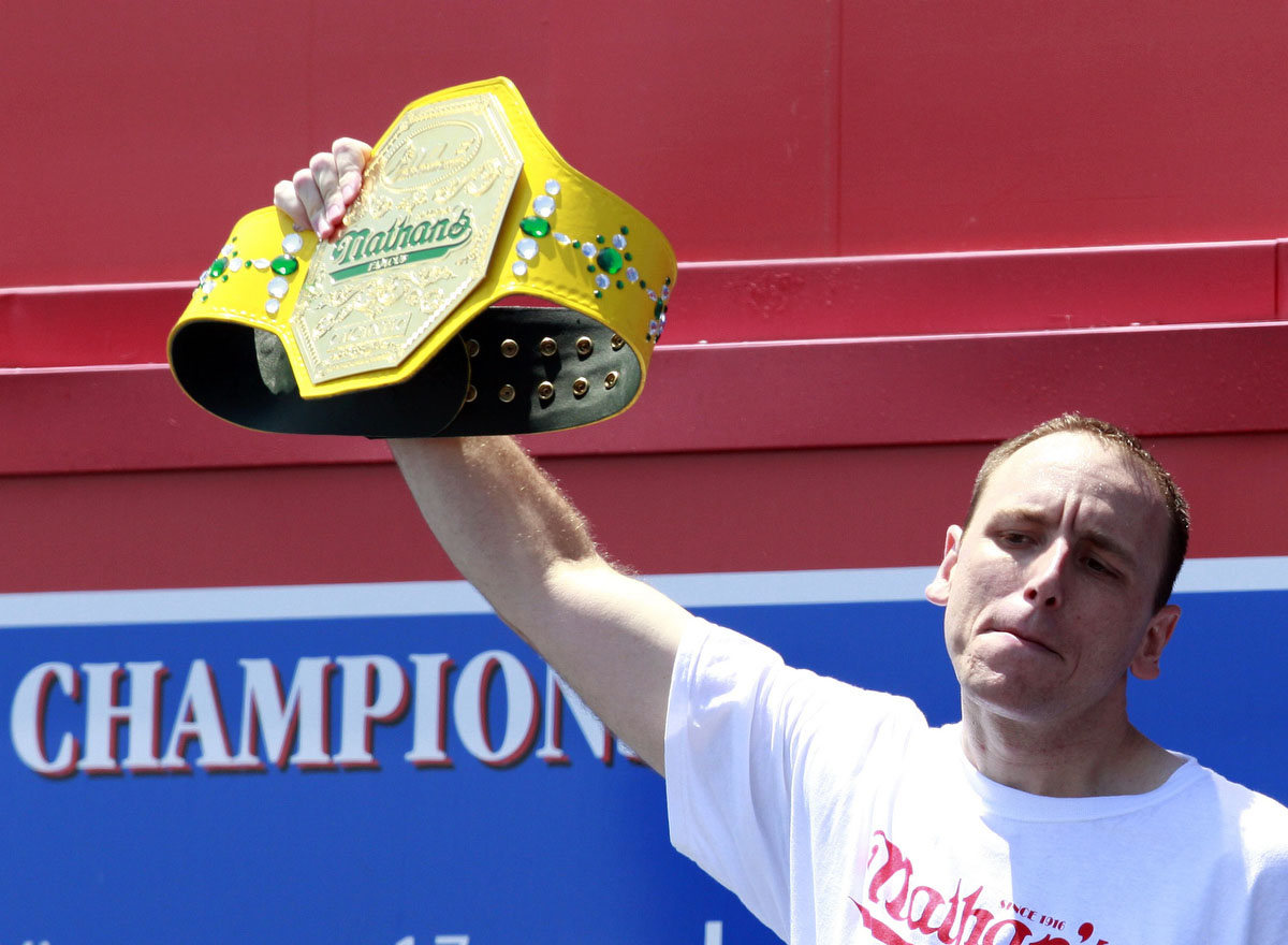 Joey Chestnut is introduced at the 2012 Nathan's Famous Fourth of July International Eating Contest at Coney Island in the Brooklyn borough of New York. Chestnut ate a record-tying 68 hot dogs to take the crown. (Eric Thayer, Reuters photo)
