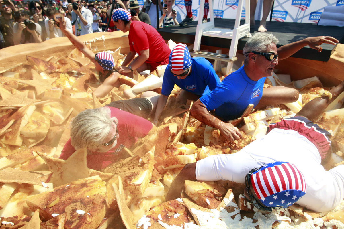Contestants compete in an Apple Pie Dive before the 2012 Nathan's Famous Fourth of July International Eating Contest at Coney Island in the Brooklyn borough of New York. (Eric Thayer, Reuters photo)