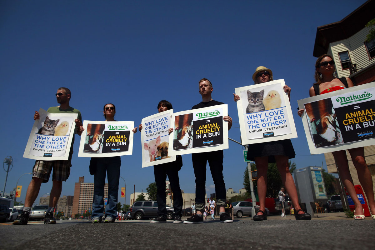 Animal rights activists protest before the 2012 Nathan's Famous Fourth of July International Eating Contest at Coney Island in the Brooklyn borough of New York. (Eric Thayer, Reuters photo)