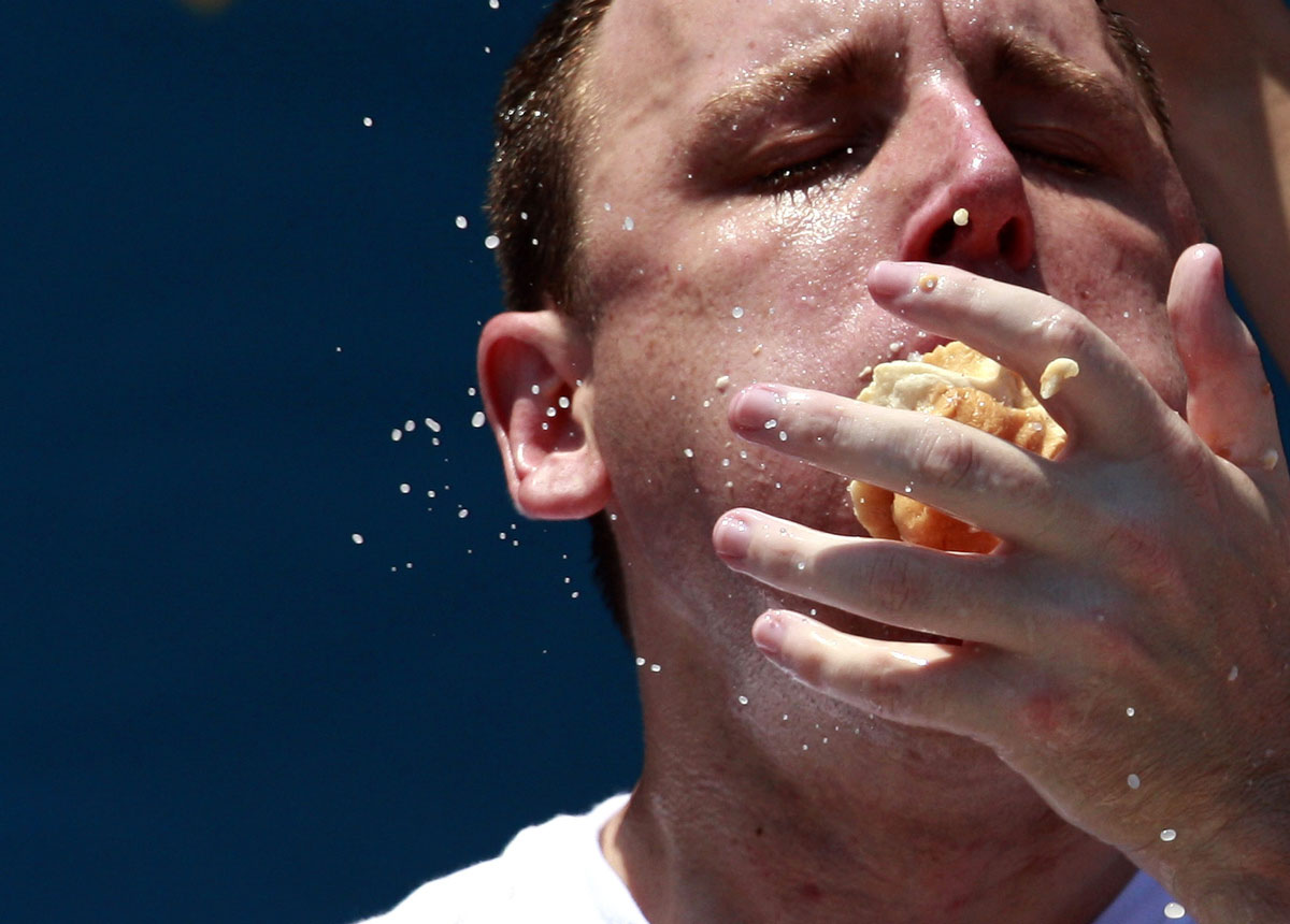 Joey Chestnut competes in the 2012 Nathan's Famous Fourth of July International Eating Contest at Coney Island in the Brooklyn borough of New York . (Eric Thayer, Reuters photo)