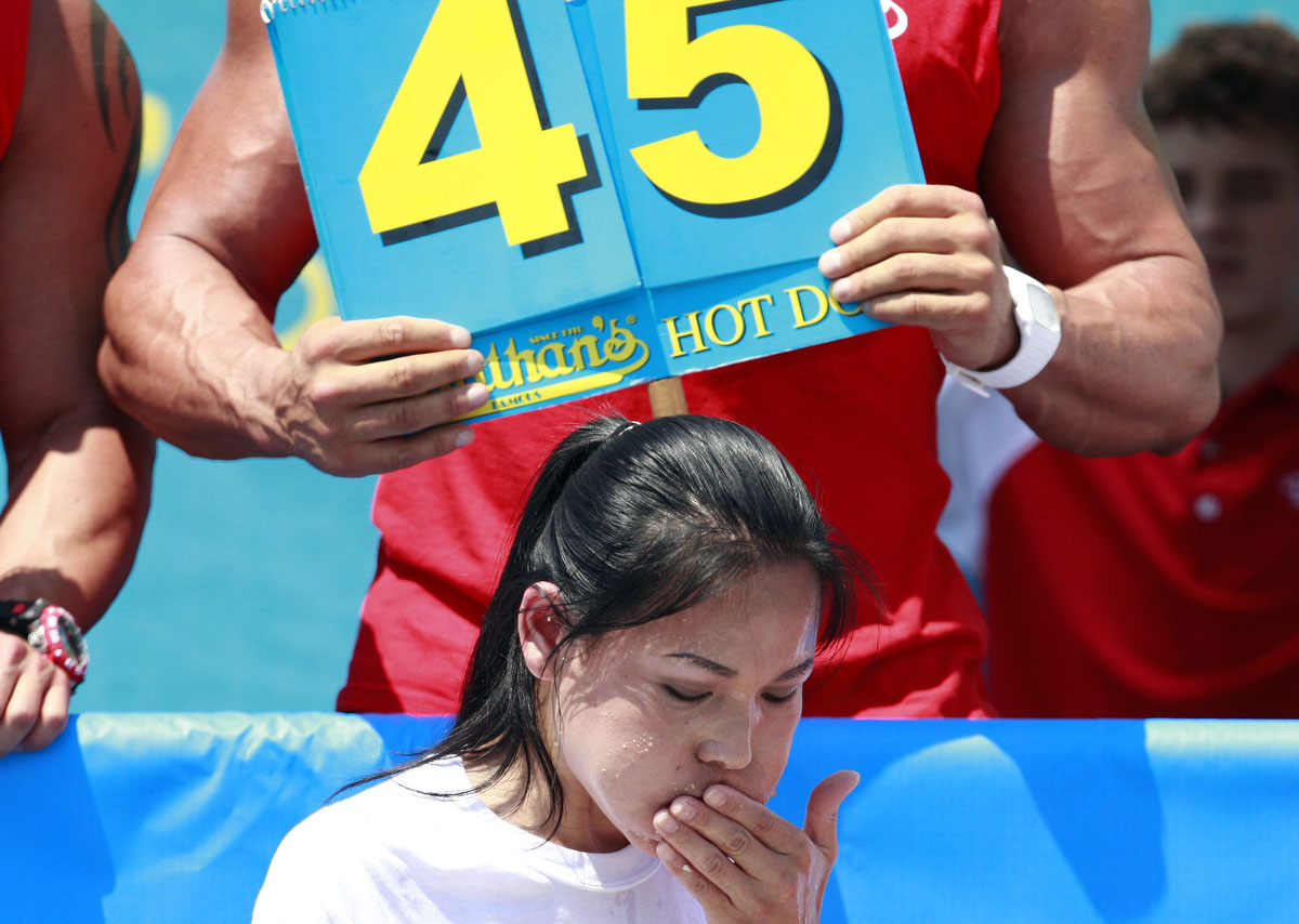 Sonya Thomas competes in the 2012 Nathan's Famous Fourth of July International Eating Contest at Coney Island in the Brooklyn borough of New York. Thomas broke her record by eating 45 hot dogs to take the crown. (Eric Thayer, Reuters photo)