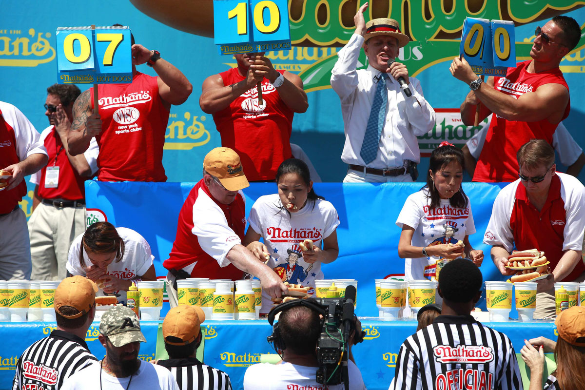 Contestants compete in the 2012 Nathan's Famous Fourth of July International Eating Contest at Coney Island in the Brooklyn borough of New York. Sonya Thomas (C) broke her record by eating 45 hot dogs to take the crown. (Eric Thayer, Reuters photo)
