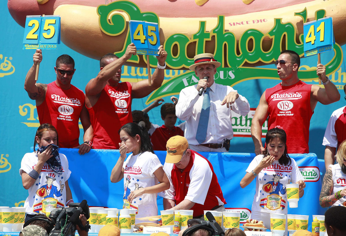 Contestants compete in the 2012 Nathan's Famous Fourth of July International Eating Contest at Coney Island in the Brooklyn borough of New York. (Eric Thayer, Reuters photo)