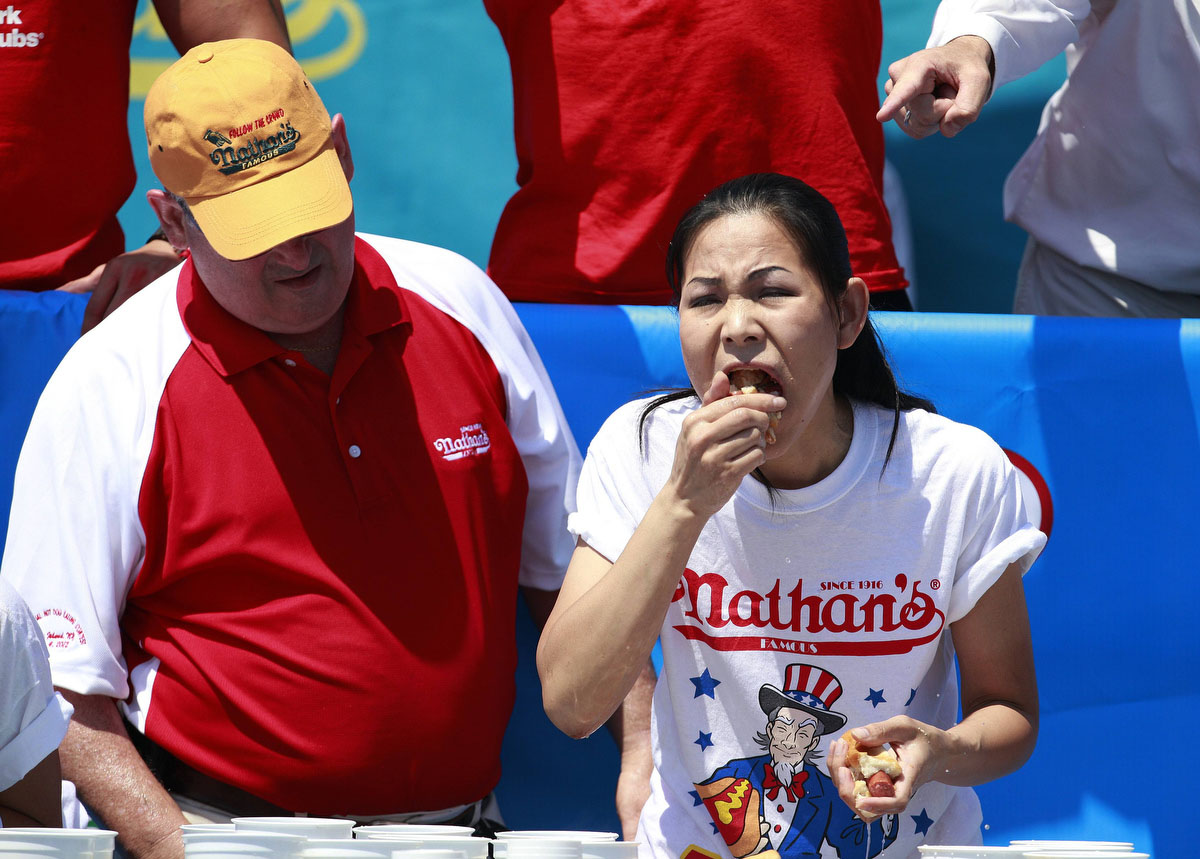 Sonya Thomas competes in the 2012 Nathan's Famous Fourth of July International Eating Contest at Coney Island in the Brooklyn borough of New York . (Eric Thayer, Reuters photo)