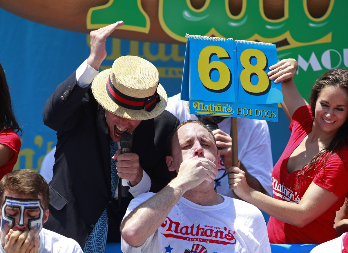 Joey Chestnut competes in the 2012 Nathan's Famous Fourth of July International Eating Contest at Coney Island in the Brooklyn borough of New York July 4, 2012. Chestnut ate a record-tying 68 hot dogs to take the men's crown. (Eric Thayer, Reuters photo)