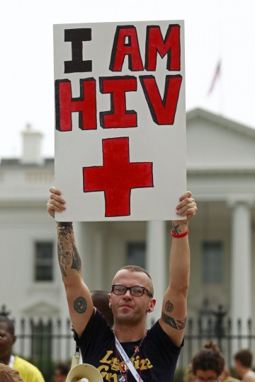 AIDS activist Aaron Laxton of St. Louis, Missouri, takes part in a rally in front of the White House in Washington. The international AIDS 2012 conference is currently being held in Washington. (Kevin Lamarque/Reuters)
