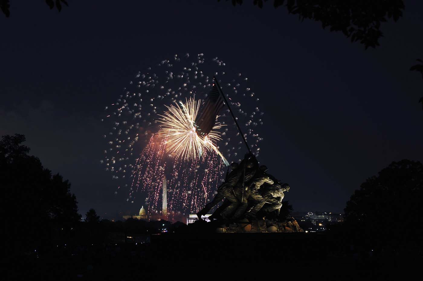 ARLINGTON, VA - JULY 04: An Independence Day fireworks display lights up the sky over Washington, as seen from the U.S. Marine Corps Memorial in Arlington, Virginia. (Jonathan Ernst/Reuters)