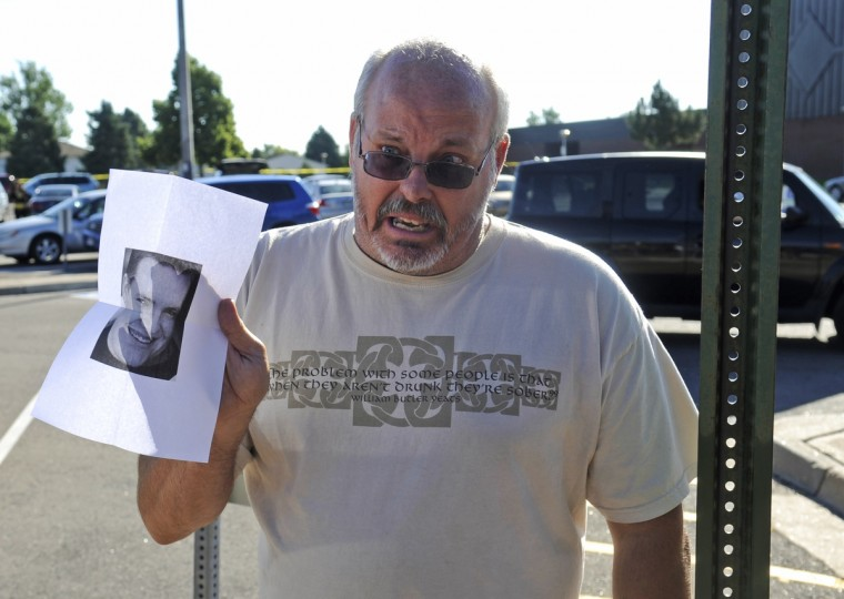 Tom Sullivan holds up a photo of his son Alex Sullivan pleading the media to help find him, outside Gateway High School a few blocks from the scene of the Century 16 Theatre shootings in Aurora, Colorado. (Evan Semon/Reuters photo)