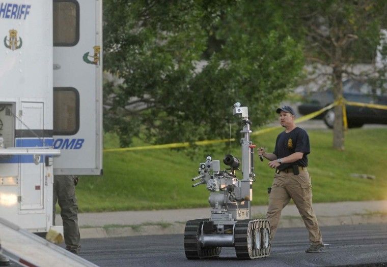 "The Aurora bomb squad robot is deployed to search a suspect's car behind the Century 16 Theatre following a shooting during a ""Batman"" movie screening in Aurora, Colorado. (Evan Semon/Reuters photo)"