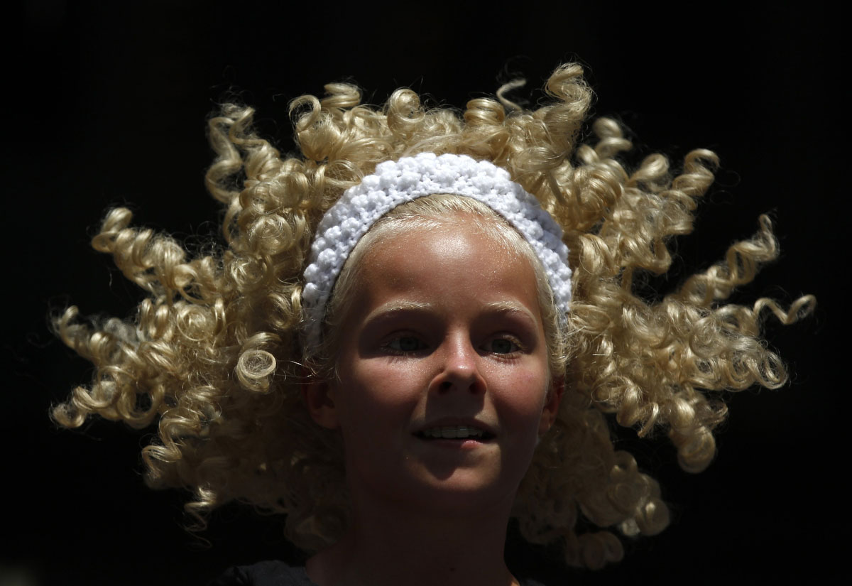 A member of the Trinity Irish Dancers performs outside Daley Center in Chicago. Temperatures in the Chicago area are expected to reach 105 degrees Fahrenheit (41 degrees Celsius). (Jeff Haynes/Reuters)