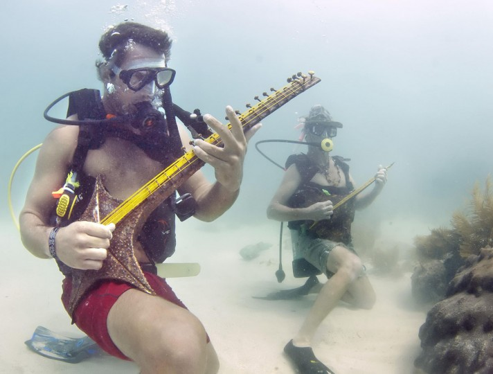 Divers strum on an artist's marine-themed musical instruments at the Lower Keys Underwater Music Festival in the Florida Keys National Marine Sanctuary off Big Pine Key. About 300 divers and snorkelers listened to a local radio station's four-hour broadcast piped beneath the sea via underwater speakers suspended from boats. (Bill Keogh/Florida Keys News Bureau/HO/Reuters)