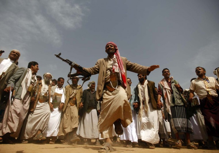 A tribesman, loyal to the al-Houthi Shi'ite rebel group, performs a traditional dance at the conclusion of a two-day tribal gathering in the northwestern Yemeni province of Saada, on the border with Saudi Arabia(Khaled Abdullah/Reuters photo)