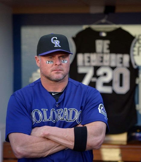 """Colorado Rockies first baseman Jason Giambi (23) wears eye black with """"7-20"""" in honor of the victims of the Aurora, CO shooting before a game against the San Diego Padres at PETCO Park. The team also displayed a jersey with the phrase """"We Remember"""" and today's date. (Jake Roth/US-PRESSWIRE)"""