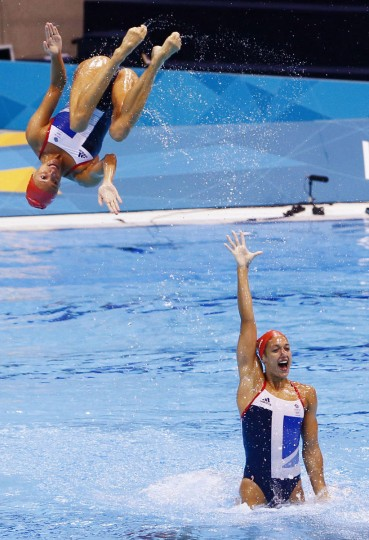 The United Kingdom Synchronized Swimming team works on their routine during a practice session three days before the 2012 London Olympic Games at the Aquatics Center. (Rob Schumacher/USA TODAY Sports/US Presswire)